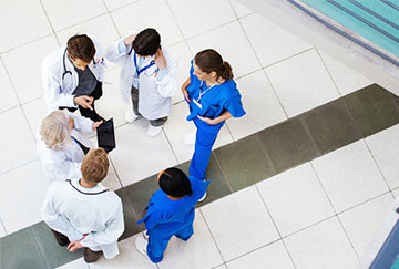 Healthcare professionals in a huddle