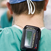 Clinician with Pager on his back
